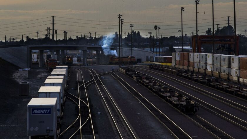 SAN BERNARDINO, CA - FEBRUARY 2, 2017: Smoke billows form a locomotive at the San Bernardino rail y