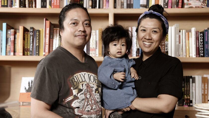 Now Serving cookbook store owners Ken Concepcion and Michelle Mungcal, and their daughter, Frankie.
