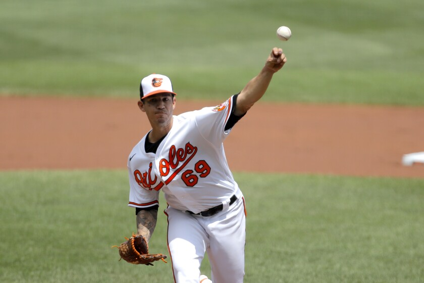 Baltimore Orioles starting pitcher Tommy Milone throws a pitch to the Tampa Bay Rays during the first inning of a baseball game, Sun, Aug. 2, 2020, in Baltimore. (AP Photo/Julio Cortez)