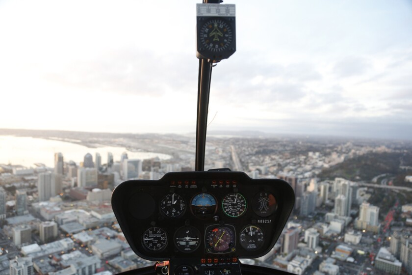 The Romance Tours by Corporate Helicopters passes over downtown San Diego.