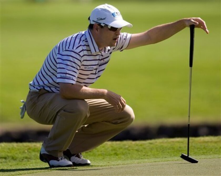 Zach Johnson lines up a putt on the third green during the final round of the Sony Open golf tournament at the Waialae Country Club, Sunday, Jan. 18, 2009, in Honolulu. (AP Photo/Marco Garcia)