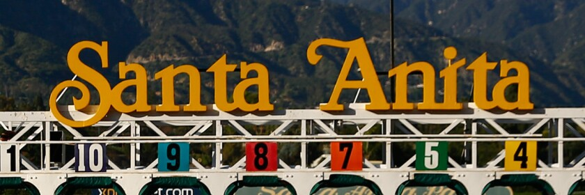 The starting gate is moved after a race at Santa Anita Park in Arcadia.