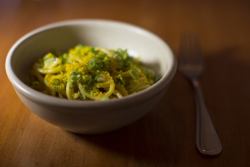 """The second of a four-course offering at Lasa: """"Pancit"""" egg noodle made with calamansi butter, scallions and patis cured egg yolk."""
