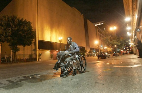 """Joe McMichaels, 62, rolls down Main Street in Los Angeles. """"I got hit by a truck,"""" he says. It happened two years ago. """"My leg is gone forever."""""""