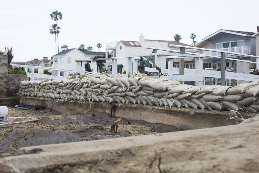 A temporary seawall to prevent flooding during high tide in Newport Beach.
