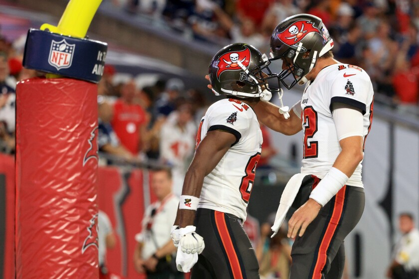 Antonio Brown and Tom Brady of the Tampa Bay Buccaneers celebrate their touchdown against the Dallas Cowboys .