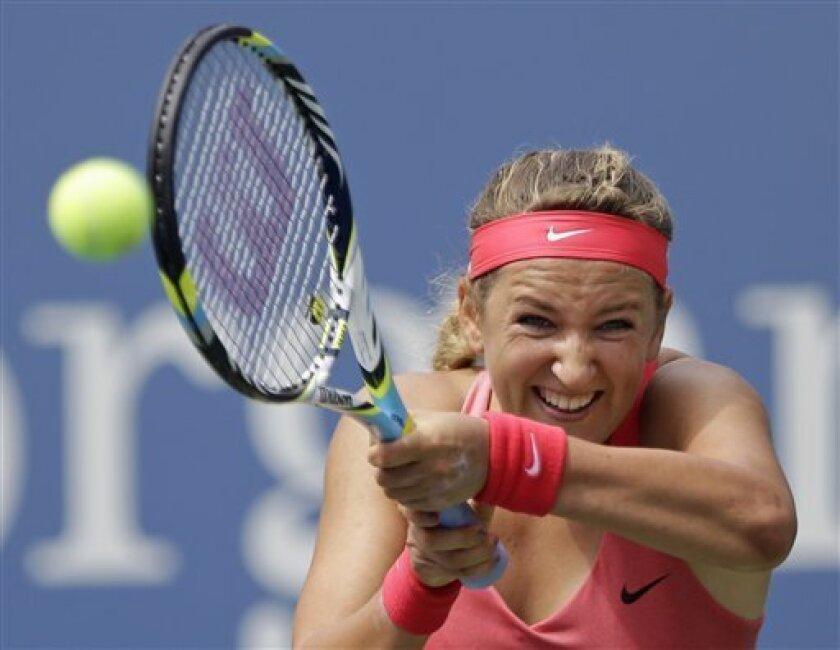 Victoria Azarenka, of Belarus, returns a shot toAna Ivanovic, of Serbia, during the quarterfinals of the 2013 U.S. Open tennis tournament, Tuesday, Sept. 3, 2013, in New York. (AP Photo/Julio Cortez)