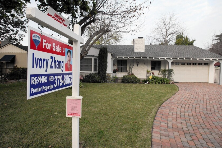 Home prices stayed essentially flat in February while sales tumbled. Some experts think the market has flattened, with only moderate price appreciation ahead in 2014. Above, a home for sale this month in Alhambra.