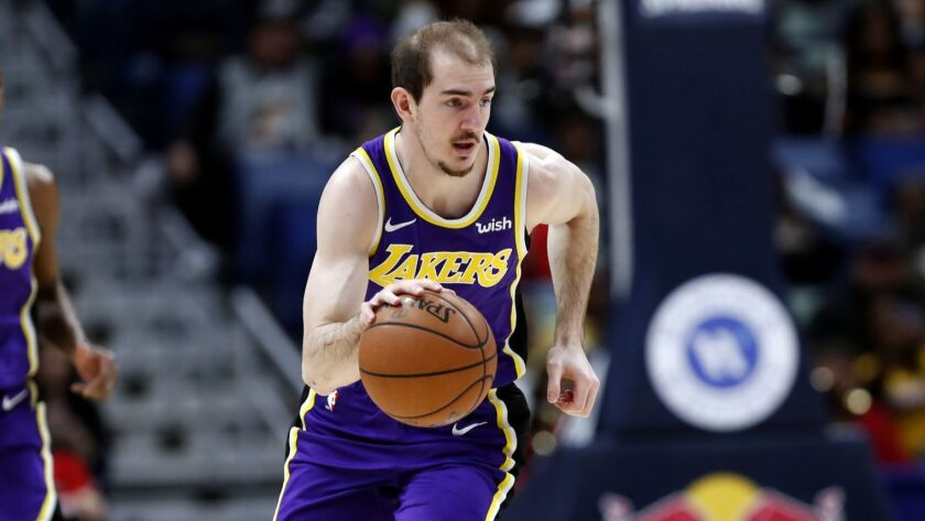 Alex Caruso of the Lakers dribbles against New Orleans.