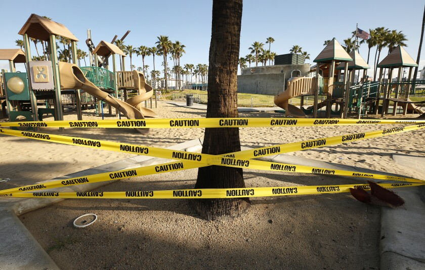 A playground cordoned off with caution tape