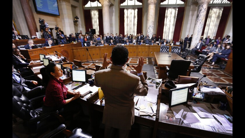 Los Angeles City Council President Herb Wesson, center, speaks at Los Angeles City Hall before the City Council voted on an ordinance to raise the minimum wage in Los Angeles to $15 per hour by 2020.