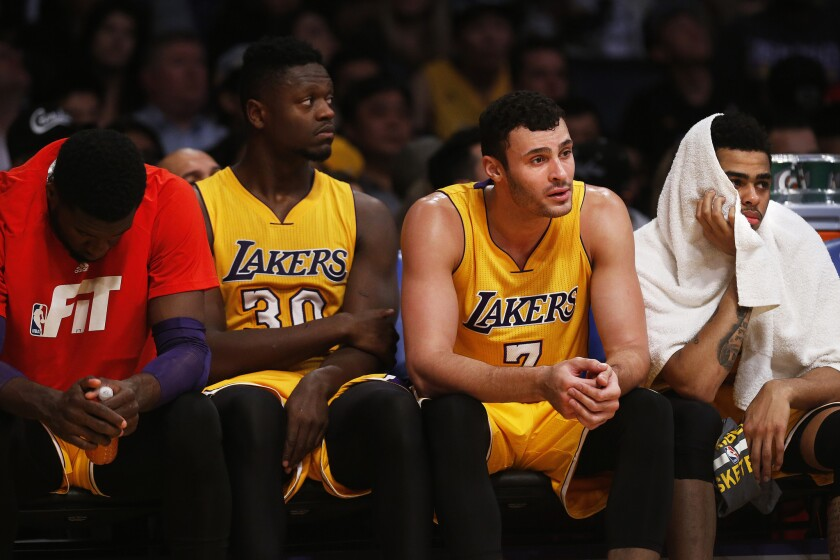 The Lakers rookies watch the final moments of a 114-91 loss to the Bulls from the bench.