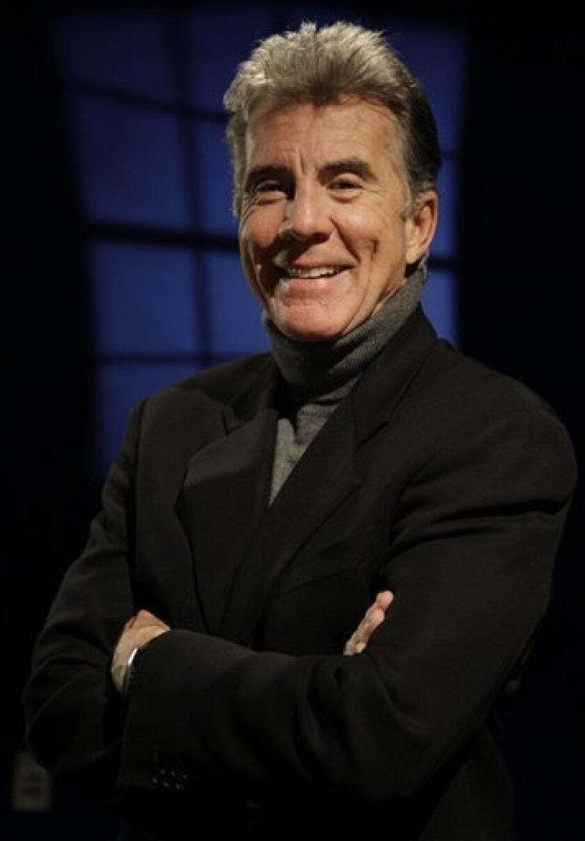 """FILE-  This March 12, 2009 file photo shows John Walsh, host of the television show """"America's Most Wanted,""""  in New York. This week marks the final weekly airing of """"America's Most Wanted"""" on the Fox network after 23 years and 1153 fugitives nabbed.    (AP Photo/Julie Jacobson, FILE)"""