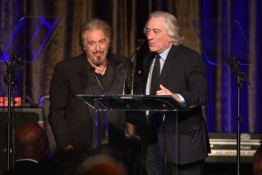 Honoree Al Pacino, left, and actor Robert De Niro onstage at the American Icon Awards gala in Beverly Hills on Sunday.