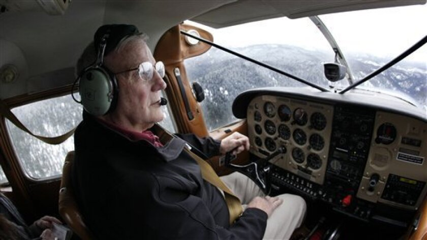 FILE - In this  April 15, 2009 photo, Ray Arnold pilots the Cessna 185 airplane he uses to deliver mail and other supplies to the remote Idaho backcountry, over central Idaho's Frank Church-River of No Return Wilderness. Arnold flies the only backcountry air mail route left in the lower 48 states,