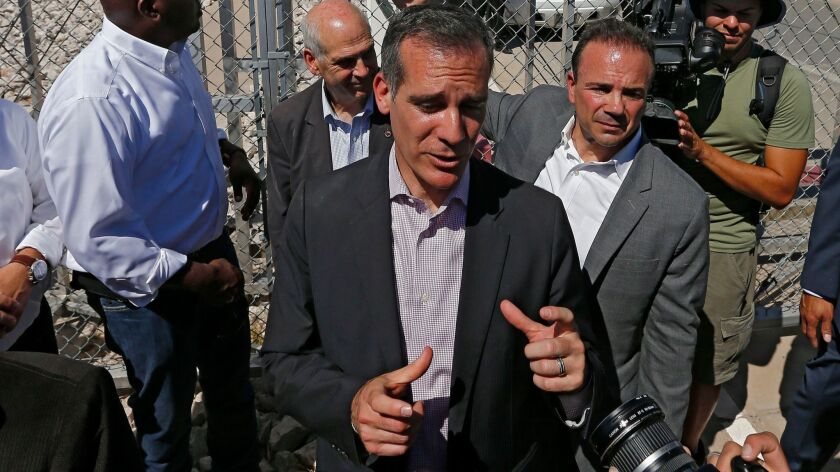 Los Angeles Mayor Eric Garcetti takes part in a protest by mayors at the Tornillo Port of Entry in Tornillo, Texas, on June 21.