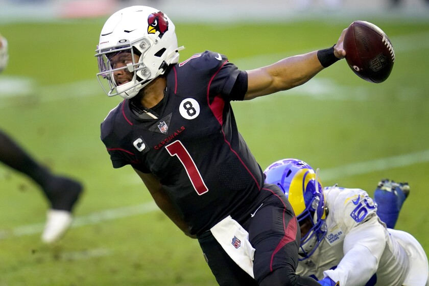 Arizona Cardinals quarterback Kyler Murray (1) eludes the reach of Los Angeles Rams outside linebacker Samson Ebukam (50) during the first half of an NFL football game, Sunday, Dec. 6, 2020, in Glendale, Ariz. (AP Photo/Ross D. Franklin)
