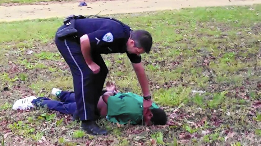 Officer Michael Slager with Walter Scott's body