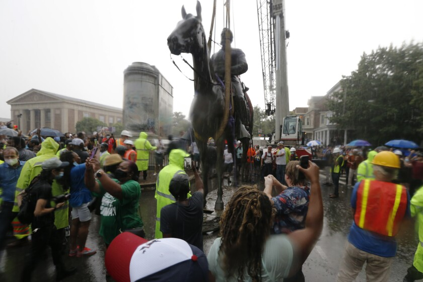 Protesters cheer as workers remove the statue of Confederate Gen. Stonewall Jackson Wednesday in Richmond, Va.