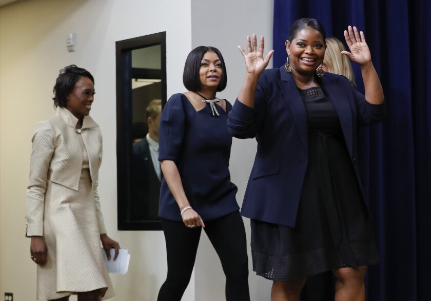 "Author Margot Lee Shetterly, actresses Taraji P. Henson and Octavia Spencer are introduced after the White House screening for ""Hidden Figures."""