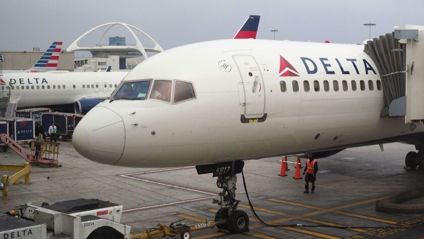 Delta Air Lines plane waits for passengers at Los Angeles International Airport
