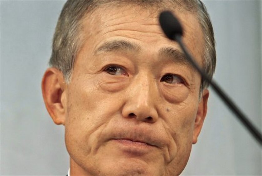 """Honda Motor Co. Chief Executive Takeo Fukui listens to a reporter's question during a press conference at the Japanese automaker's head office in Tokyo, Japan, Friday, Dec. 5, 2008. Honda has pulled out of Formula One, citing a slowdown in the global economy and a need to focus on its core business activities. """"We have come to the conclusion that we will withdraw from all Formula One activities, making 2008 the last season of participation,"""" Fukui said at the news conference. (AP Photo/Itsuo Inouye)"""