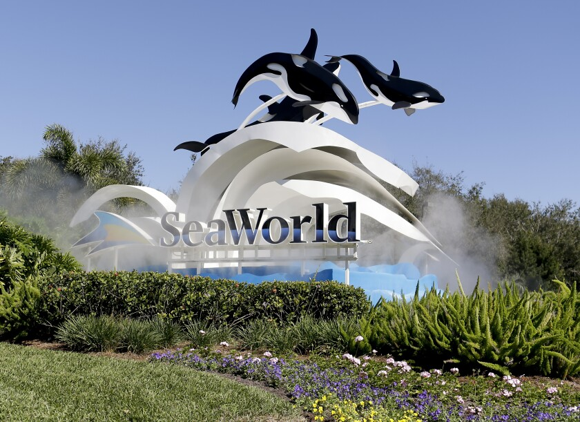 SeaWorld Parks & Entertainment has been sued in San Diego federal court for continuing to collect monthly annual pass membership fees while its parks are closed because of the coronavirus pandemic.