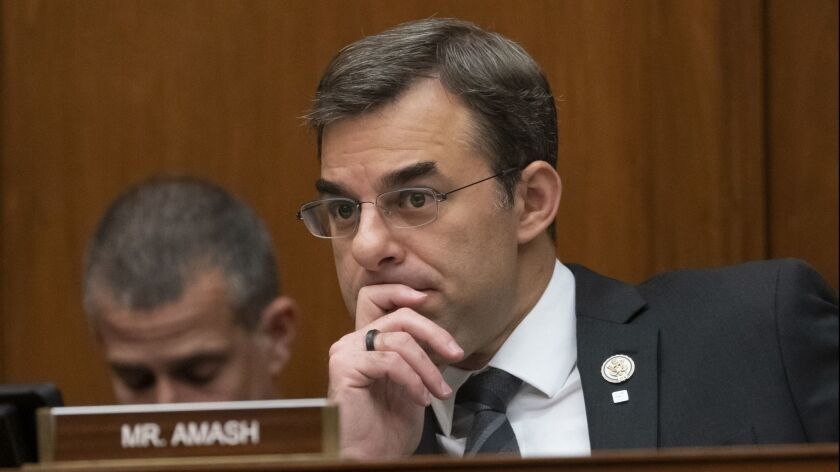 Rep. Justin Amash (R-Mich.) listens to debate during a House Oversight and Reform Committee meeting on June 12.