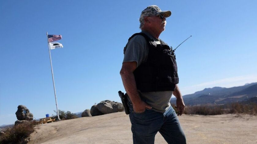 Robert Crooks is one of several armed militiamen who have been patrolling the U.S.-Mexico border near Campo, Calif.