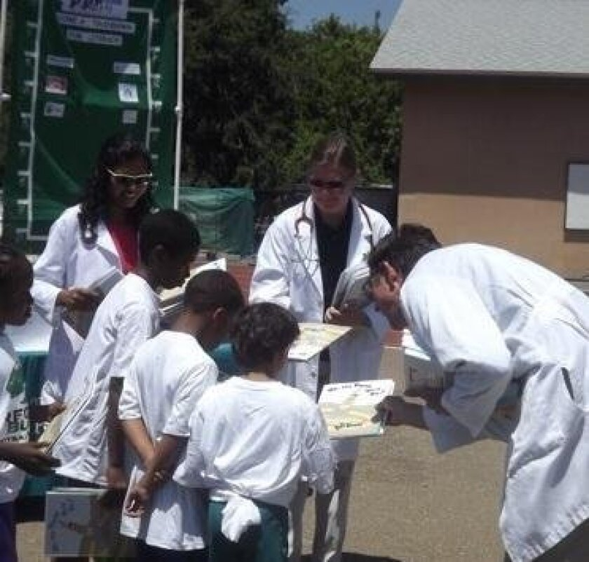 Doctors handing out books and prescribing reading.