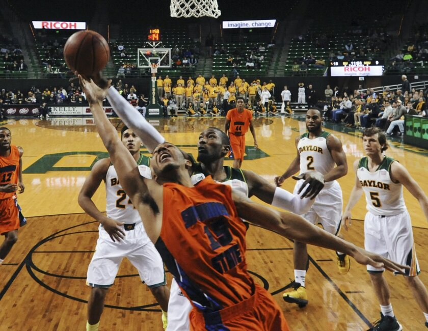 Savannah State guard Keierre Richards (15) reaches for a rebound with Baylor forward Cory Jefferson during the first half of an NCAA college basketball game, Friday, Jan. 3, 2014, in Waco, Texas. (AP Photo/Waco Tribune Herald, Rod Aydelotte)