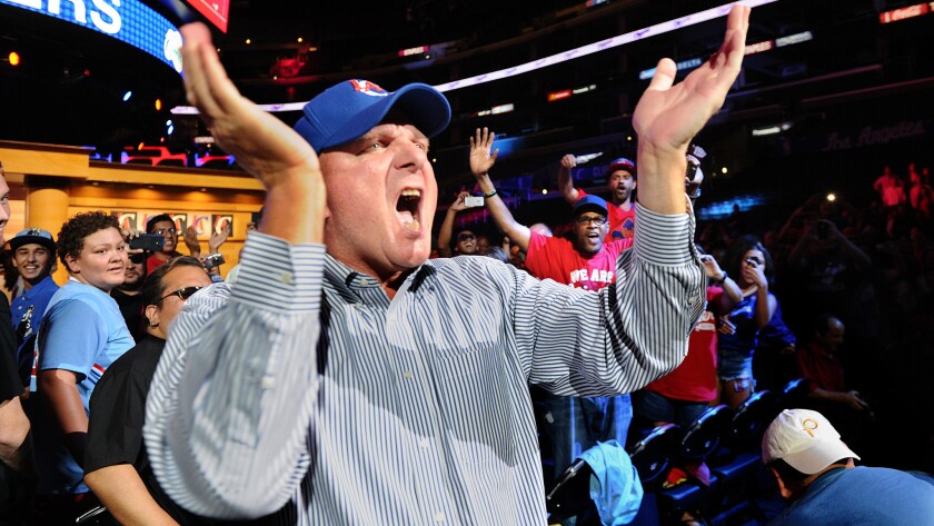 New Clippers owner Steve Ballmer cheers as he greets fans during a rally at Staples Center on Monday.