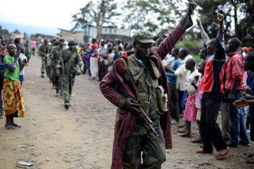 A Congolese soldier responds to residents' cheers as the army enters Bunagana, one of the towns retaken from M23 rebels in recent days.
