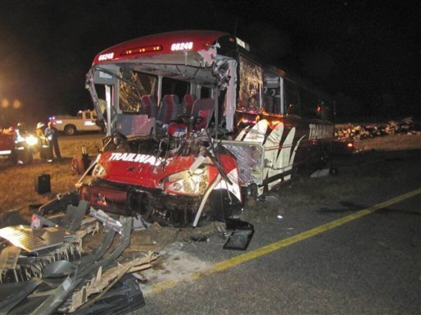 This photo provided by the Nebraska State Patrol shows a Burlington Trailways bus that crashed into a semi on Interstate 80 near Gibbon, Neb., Thursday, Oct. 6, 2011. Five people were treated at hospital after the Denver-bound bus rammed into an overturned semitrailer on Interstate 80 near Gibbon, Neb., early Thursday. The Nebraska State Patrol says 41 people were taken to a hospital in Kearney, where 30 people had been treated and released. Of the five admitted, one was in critical condition and one was in serious condition. The other passengers spent about two hours at an American Red Cross shelter until the bus operator could get another bus there. (AP Photo/Nebraska State Patrol)