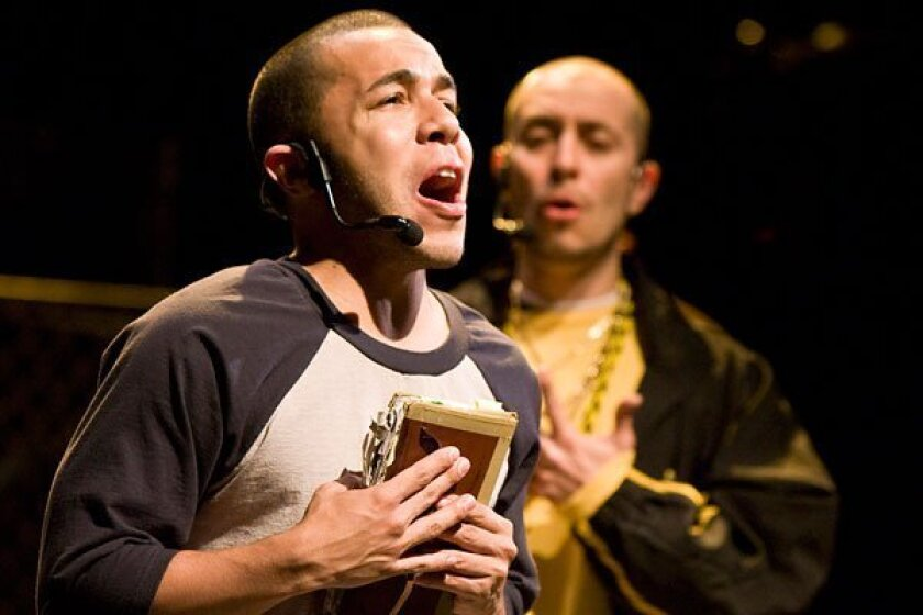 """Cedric Leiba, Jr. as Juan, with Gerardo Rodriguez (behind) as Cano in The Old Globe's production of """"Kingdom."""" (Craig Schwartz photo)"""