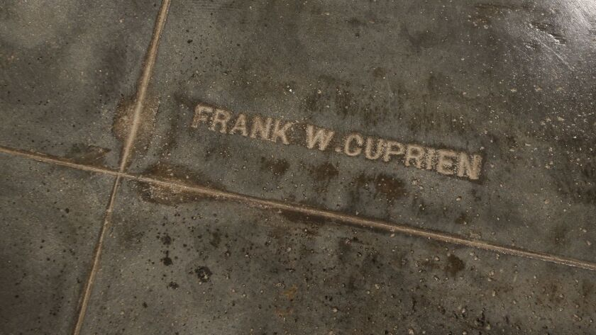 Frank Cuprien's name is seen on the restored floor of the Laguna Art Museum during grand opening on