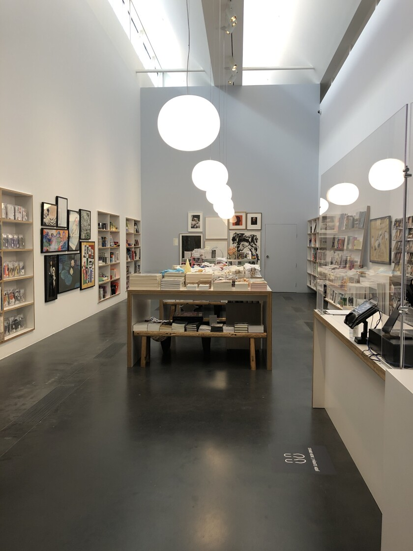 A museum gift shop lined with books and other goods.