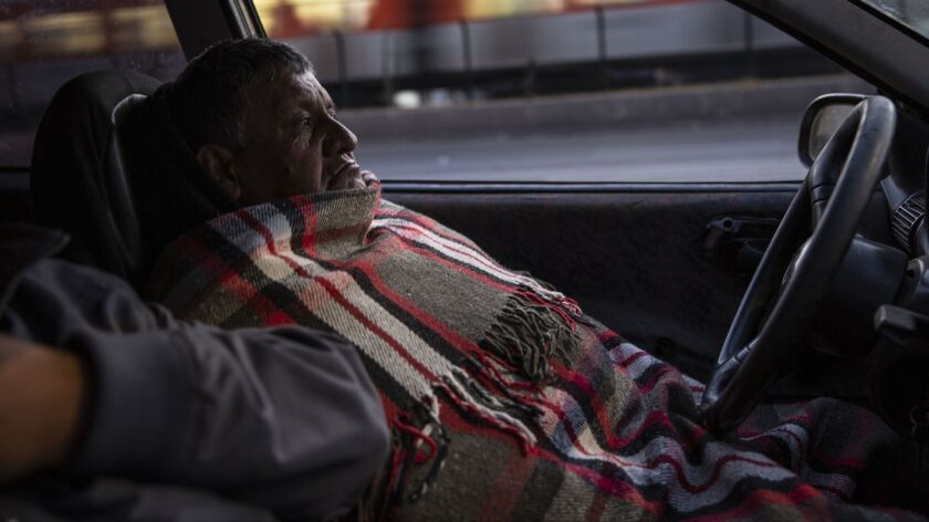 Jose Alberto Nava sleeps all night in his vehicle on Tlalpan road, waiting for gas to arrive Friday in Mexico City. President Andrés Manuel López Obrador said the shortage was caused by a sabotage in a gas pipeline.