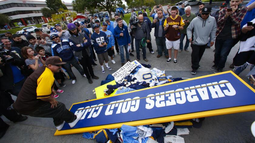 Chargers fans pile up Chargers memorabilia at the entrance to Chargers Park.