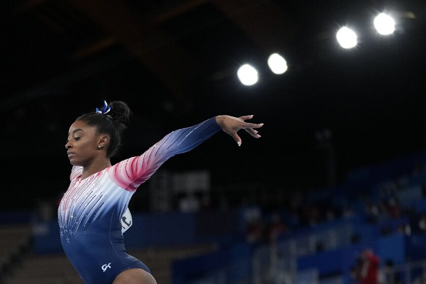 Simone Biles, of the United States, performs on the balance beam