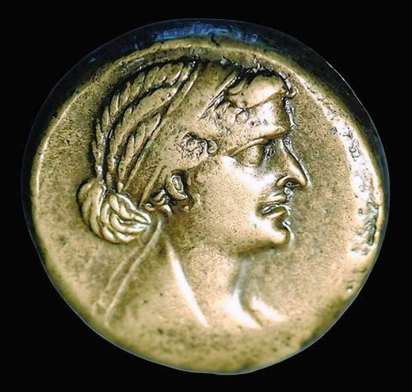 An 80-drachma bronze coin minted in Alexandria. Cleopatra reintroduced the metal, long out of production and to which she added denominational marks for the first time. Regardless of its weight, the coin was worth what she said it was worth, a profitable arrangement for her.