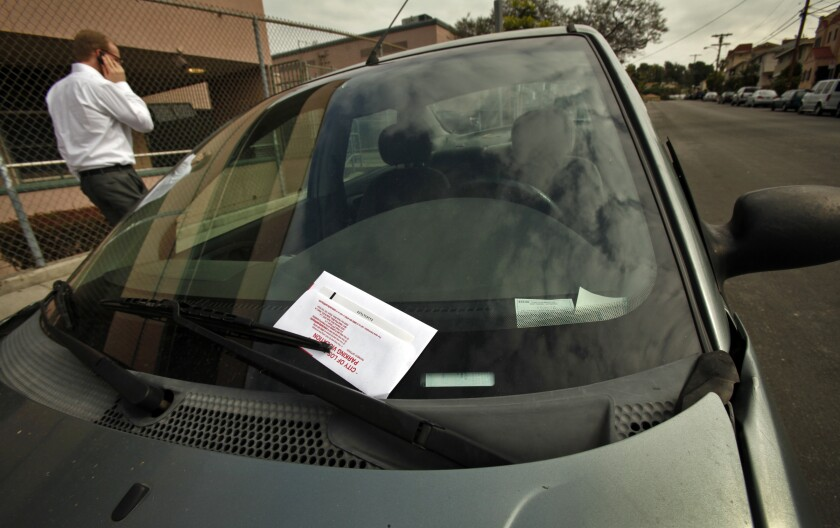 A car with a parking ticket in the Echo Park neighborhood.