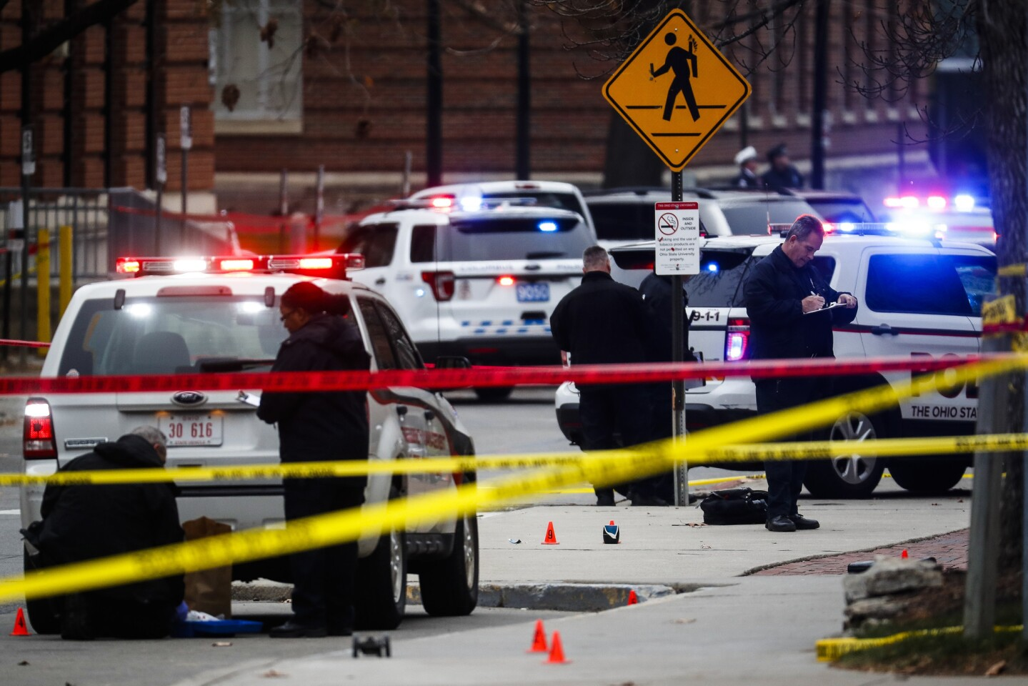 Crime scene investigators collect evidence from the scene of an attack on campus at Ohio State University.