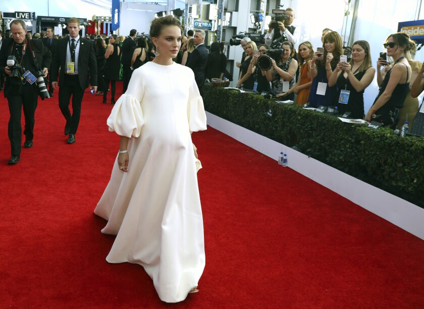 "Natalie Portman, star of ""Jackie,"" wore a very Jackie Kennedy-esque pouf-sleeved Dior ensemble to the 23rd Screen Actor Guild Awards on Sunday."