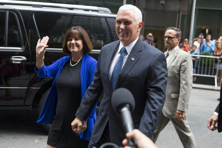 Indiana Gov. Mike Pence and his wife Karen arrive to meet with Republican presidential candidate Donald Trump at Trump Tower in New York, Friday, July 15, 2016. Trump has chosen Pence as his running mate, adding political experience and conservative bona fides to his Republican presidential ticket. (AP Photo/Evan Vucci)