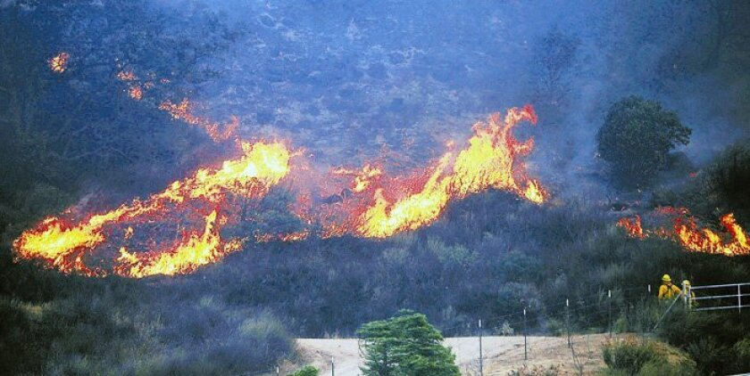 Firefighters try to get a handle on a 2007 wildfire between Ramona and Santa Ysabel.