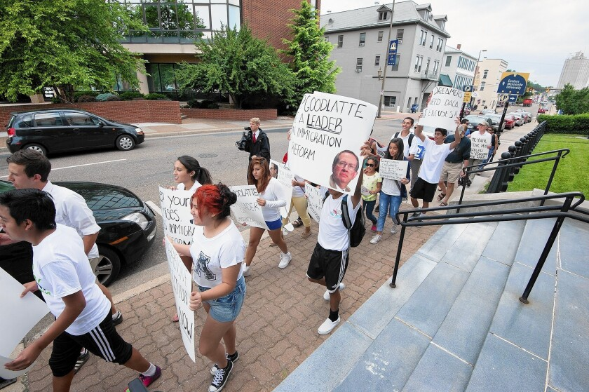 Demonstrators march in support of immigration reform in Harrisonburg, Va. Sponsors in the state have accepted 2,234 unaccompanied children caught crossing the U.S. border illegally.