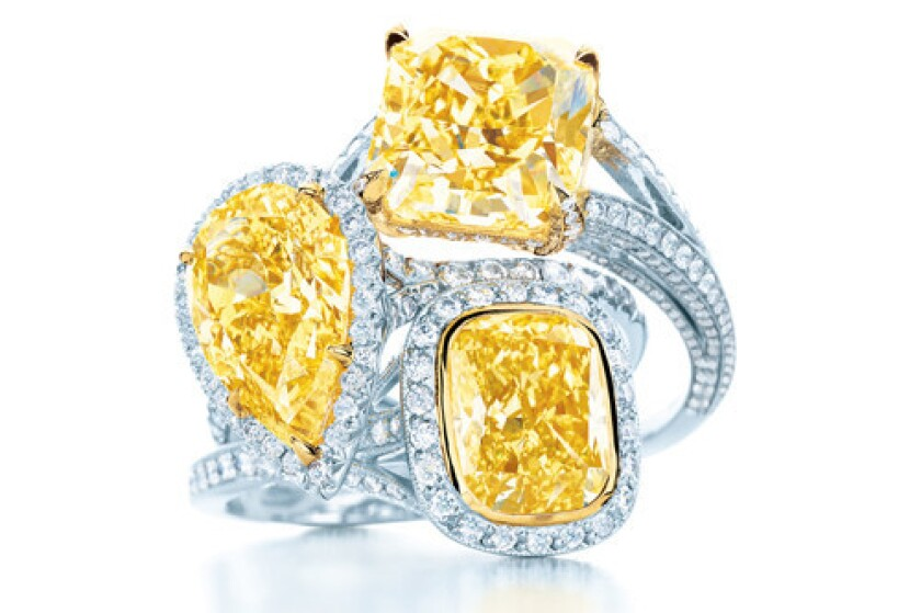 Tiffany yellow-diamond rings with white diamonds and platinum and 18-karat-gold settings.