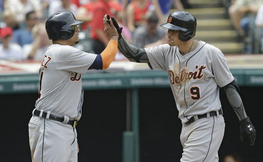 Detroit Tigers' Nick Castellanos, right, and Victor Martinez celebrate after a three-run home run by Nick Castellanos in the fifth inning of a baseball game, Wednesday, July 6, 2016, in Cleveland. Martinez and Miguel Cabrera scored on the play. (AP Photo/Tony Dejak)