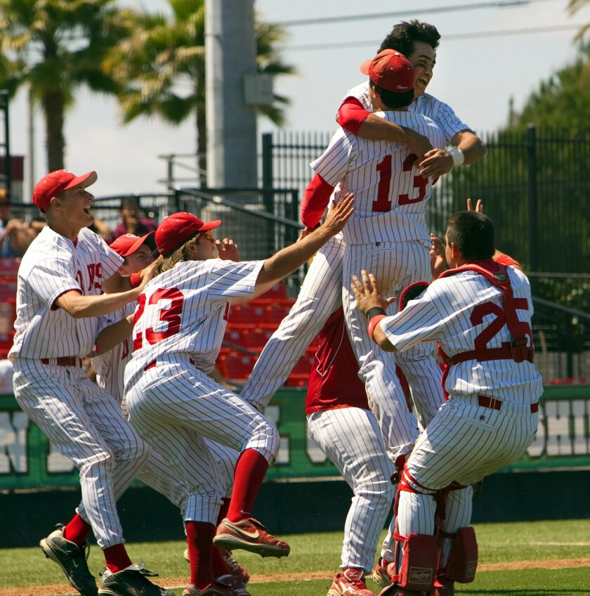 Winning pitcher Daniel Camarena (13) receives a flying embrace from Eric Sapp after Cathedral Catholic clinched the San Diego Section Division III baseball title at Tony Gwynn Stadium.